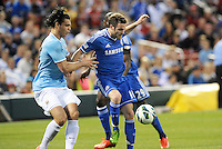 Juan Mata (10) Chelsea watched by Manchester City defender Karim Rekik.Manchester City defeated Chelsea 4-3 in an international friendly at Busch Stadium, St Louis, Missouri.