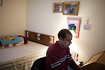 December 16, 2010. Raleigh, NC.. Between his work shifts, TP Mishra edits the Bhutan News Service from his bedroom. The BNS is English language news website that aggregates news about issues that are of interest to refugees of Bhutan.. TP Mishra, a refugee from Bhutan, has recently relocated from the Bronx to Raleigh, where he lives in an suburban apartment  with his wife, as well as another Bhutanese couple.