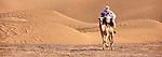 Nomad on dromedary in the Sahara desert in Morocco.