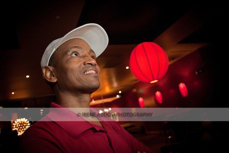 An African-American man bowls at Lucky Strike Bowling Alley at the Verizon Center in Washington DC.