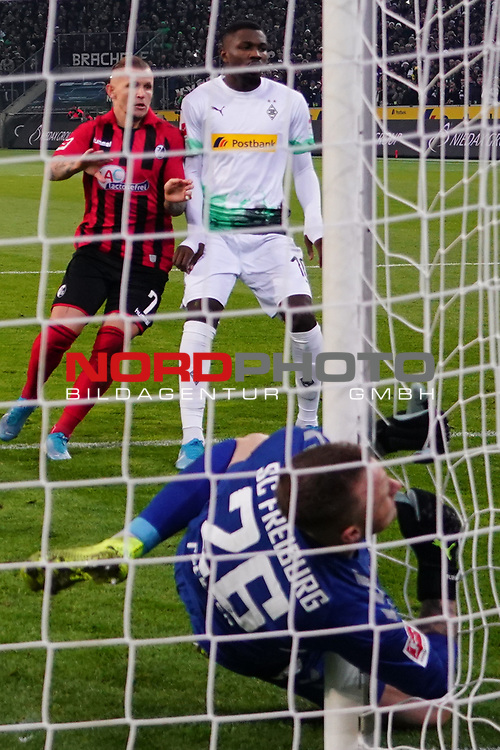 01.12.2019, Borussia Park , Moenchengladbach, GER, 1. FBL,  Borussia Moenchengladbach vs. SC Freiburg,<br />  <br /> DFL regulations prohibit any use of photographs as image sequences and/or quasi-video<br /> <br /> im Bild / picture shows: <br /> Nachschuss 11 Meter Ramy Bensebaini (Gladbach #25),  und Laszlo Benes (Gladbach #22), haelt Mark Flekken Torwart (Freiburg #26), auch und kollidiert mit dem Pfosten<br /> <br /> Foto © nordphoto / Meuter