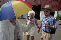 Irene O'Neill of Bellingham, and Dale Watt of Scotts Valley, Ca talk to a lady in a sun hat. NW Washington Fair. August 19, 2009 PHOTOS BY MERYL SCHENKER