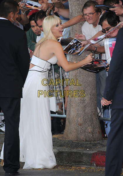 "ANNA FARIS.The Columbia Pictures' Premiere of ""House Bunny"" held at The Mann Village Theatre in Westwood, California, USA..August 20th, 2008.full length white dress mouth open fans crowd signing autographs funny.CAP/DVS.©Debbie VanStory/Capital Pictures."