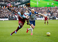 1st February 2020; London Stadium, London, England; English Premier League Football, West Ham United versus Brighton and Hove Albion; Michail Antonio of West Ham United and Aaron Mooy of Brighton and Hove Albion challenge for the ball