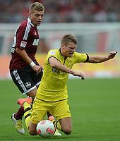 FUSSBALL   1. BUNDESLIGA  SAISON 2012/2013   2. Spieltag 1. FC Nuernberg - Borussia Dortmund       01.09.2012 Alexander Esswein (li, 1 FC Nuernberg) gegen Lukasz Piszczek (Borussia Dortmund)