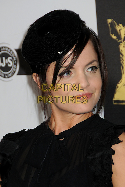 MENA SUVARI .25th Annual Film Independent Spirit Awards - Arrivals held at the Nokia Event Deck at L.A. Live, Los Angeles, California, USA..March 5th, 2010.headshot portrait hat sequined sequins beret fringe hair over face black ruffle trim ruffle .CAP/ADM/BP.©Byron Purvis/AdMedia/Capital Pictures.