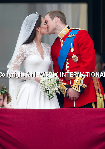 "THE KISS.Kate and William share a pasionate kiss whilst Grace Van Cutsem covers her ears and looks on bored.THE ROYAL WEDDING.Prince William and Catherine Middleton delight the crowds with a kiss..The Newly married coupleThe Duke and Duchess of Cambridge take in the splendor of the crowds from the balcony of Buckingham Palace..Prince William and Catherine Middleton marry at Westminster Abbey..The Duke and Duchess of Cambridge London_29/04/2011.Mandatory Photo Credit: ©Dias/Newspix International..**ALL FEES PAYABLE TO: ""NEWSPIX INTERNATIONAL""**..PHOTO CREDIT MANDATORY!!: NEWSPIX INTERNATIONAL(Failure to credit will incur a surcharge of 100% of reproduction fees)..IMMEDIATE CONFIRMATION OF USAGE REQUIRED:.Newspix International, 31 Chinnery Hill, Bishop's Stortford, ENGLAND CM23 3PS.Tel:+441279 324672  ; Fax: +441279656877.Mobile:  0777568 1153.e-mail: info@newspixinternational.co.uk"