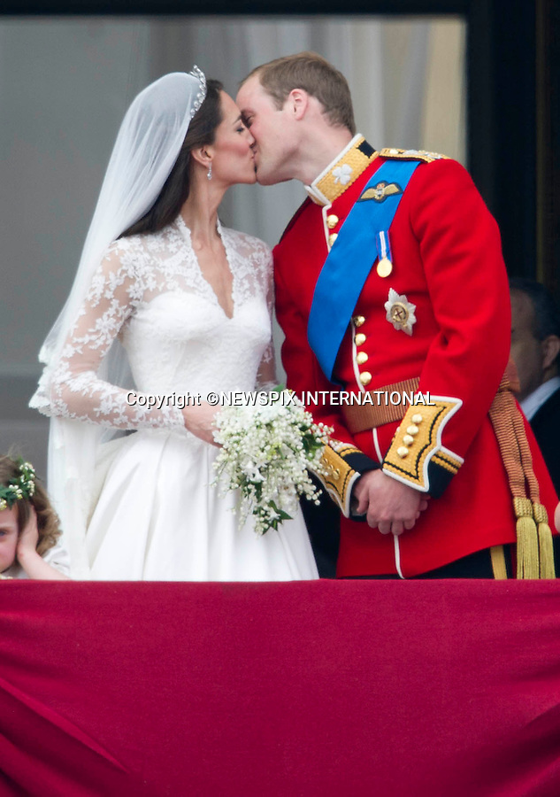 """THE KISS.Kate and William share a pasionate kiss whilst Grace Van Cutsem covers her ears and looks on bored.THE ROYAL WEDDING.Prince William and Catherine Middleton delight the crowds with a kiss..The Newly married coupleThe Duke and Duchess of Cambridge take in the splendor of the crowds from the balcony of Buckingham Palace..Prince William and Catherine Middleton marry at Westminster Abbey..The Duke and Duchess of Cambridge London_29/04/2011.Mandatory Photo Credit: ©Dias/Newspix International..**ALL FEES PAYABLE TO: """"NEWSPIX INTERNATIONAL""""**..PHOTO CREDIT MANDATORY!!: NEWSPIX INTERNATIONAL(Failure to credit will incur a surcharge of 100% of reproduction fees)..IMMEDIATE CONFIRMATION OF USAGE REQUIRED:.Newspix International, 31 Chinnery Hill, Bishop's Stortford, ENGLAND CM23 3PS.Tel:+441279 324672  ; Fax: +441279656877.Mobile:  0777568 1153.e-mail: info@newspixinternational.co.uk"""