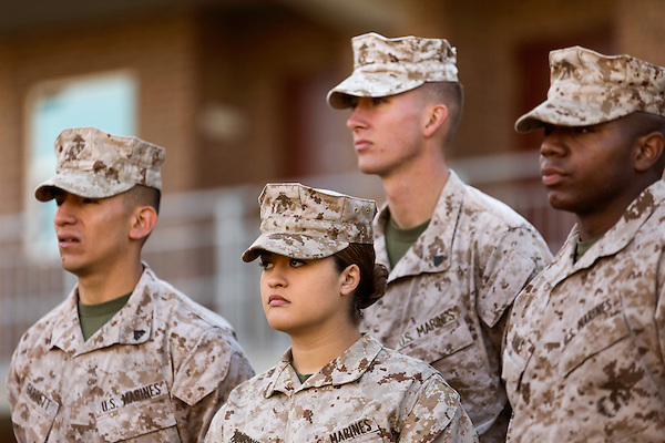 October 22, 2014. Camp LeJeune, North Carolina.<br />  LCpl. Jessica Monroy, center, and other members of the 3rd Platoon of the of the Ground Combat Element Integrated Task Force, listen to instruction before taking part in infantry patrol training. Marines in 3rd Platoon of the GCEITF are all considered provisional infantrymen as they have not been to the School of Infantry (SOI) previous to volunteering for the GCEITF.<br />  The Ground Combat Element Integrated Task Force is a battalion level unit created in an effort to assess Marines in a series of physical and medical tests to establish baseline standards as the Corps analyze the best way to possibly integrate female Marines into combat arms occupational specialities, such as infantry personnel, for which they were previously not eligible. The unit will be comprised of approx. 650 Marines in total, with about 400 of those being volunteers, both male and female. <br />  Jeremy M. Lange for the Wall Street Journal<br /> COED