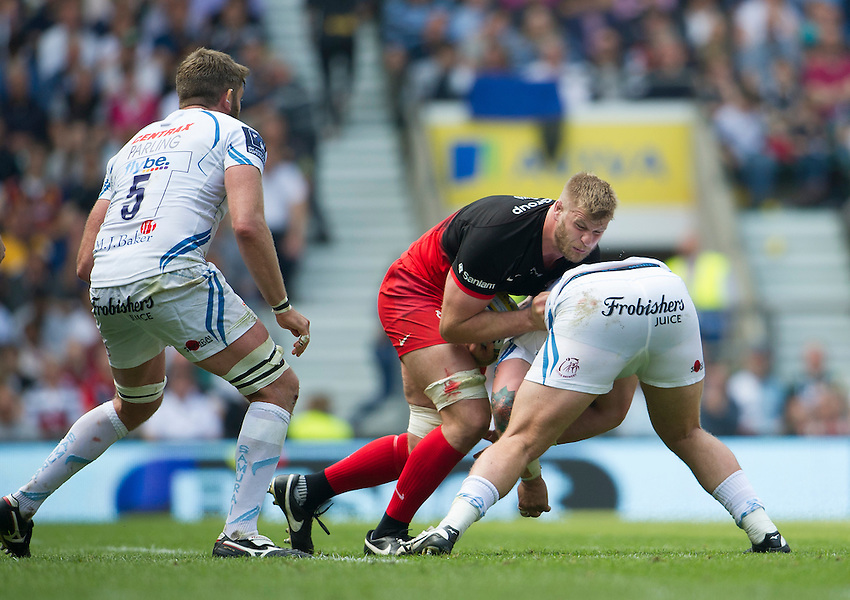 George Kruis of Saracens is tackled by Harry Williams of Exeter Chiefs<br /> <br /> Photographer Ashley Western/CameraSport<br /> <br /> Rugby Union - Aviva Premiership Final - Saracens v Exeter Chiefs - Saturday 28th May 2016 - Twickenham Stadium, Twickenham, London  <br /> <br /> World Copyright &copy; 2016 CameraSport. All rights reserved. 43 Linden Ave. Countesthorpe. Leicester. England. LE8 5PG - Tel: +44 (0) 116 277 4147 - admin@camerasport.com - www.camerasport.com