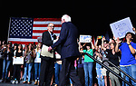 MIAMI, FL - APRIL 19: DNC Chair Tom Perez (L) shake hand of Sen. Bernie Sanders (I-VT) as he introduces him to speak during their 'Come Together and Fight Back' tour at the James L Knight Center on April 19, 2017 in Miami, Florida. Sen. Sanders and DNC Chair Tom Perez spoke about raising the minimum wage, pay equity for women, making public colleges and universities tuition-free, comprehensive immigration reform and tax reform which demands that the wealthy and large corporations start paying their fair share of taxes.  ( Photo by Johnny Louis / jlnphotography.com )