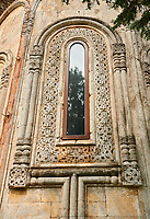 Close up picture & image of the geometric architectural stone wrok af the apse window of the medieval  Khobi Georgian Orthodox Cathedral, 10th -13th century, Khobi Monastery , Khobi, Georgia.
