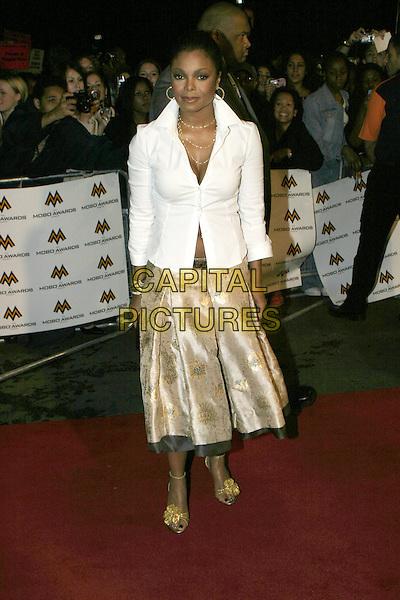 JANET JACKSON.MOBO Awards 2004 - Arrivals, Royal Albert Hall.September 30th, 2004.full length, white blouse, shirt, silk satin skirt, gold.www.capitalpictures.com.sales@capitalpictures.com.© Capital Pictures.