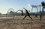 People practicing rope walking near the pierin Santa Monica, CA