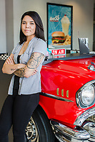 "A portrait of Brittany Atkinson, Office Manager at Hwy 55 Burgers in Mount Olive, NC Tuesday, January 8, 2019 (Justin Cook for The Wall Street Journal)<br /> <br /> Story Summary: JOBCLIMB by Chip Cutter. In this hot job market, many people have found it a good time to ask for raises, switch careers or get promoted. We talk to several people, representing a cross-section of careers, who have parlayed employers' needs for qualified talent into better jobs for themselves, advancing up the corporate ladder and earning more with every new role. Art: Brittany Atkinson cell: (919) 920-1526. Part of her story: Ms. Atkinson, 29, got hired in November as the office manager at the corporate headquarters for Hwy 55 Burgers, Shakes & Fries, a 1,500-employee restaurant franchise based in Mt. Olive, N.C. after 15 years waiting tables at Ruby Tuesdays and Buffalo Wild Wings. She has been told repeatedly by customers that she would never get an office job with better pay, benefits and weekends off because of her looks - covered in tattoos. In the tight job market, ""it's so much easier to kind of weasel your way in and get your foot in the door than it has been in the past,"" she said. ""I don't think years ago I would have been able to find this job the way I had."""