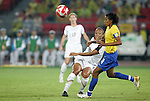 21 August 2008: Angela Hucles (USA) (16) sends the ball past Tania (BRA) (4). The United States Women's National Team defeated Brazil's Women's National Team 1-0 after extra time at the Worker's Stadium in Beijing, China in the Gold Medal match in the Women's Olympic Football tournament.