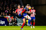 Rodrigo Cascante of Atletico de Madrid (L) competes for the ball with Iker Muniain Goni of Athletic de Bilbao during the La Liga 2018-19 match between Atletico de Madrid and Athletic de Bilbao at Wanda Metropolitano, on November 10 2018 in Madrid, Spain. Photo by Diego Gouto / Power Sport Images