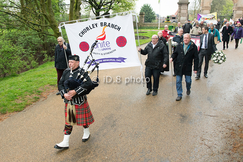 Piper Bob Wilson leads the Chorley Workers' Memorial Day procession