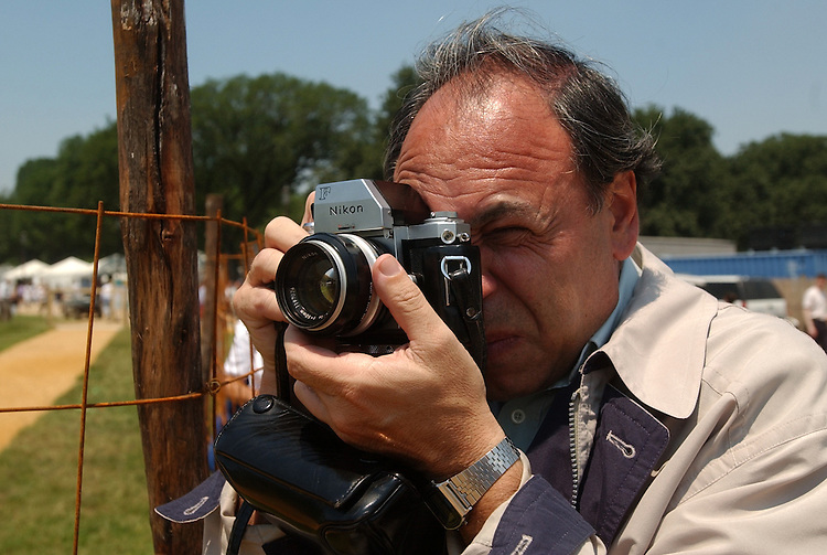 festival9/062503 - A man uses a Nikon F at the 37th Annual Smitnsonian Folklife Festival, in the Scotland exhibit.