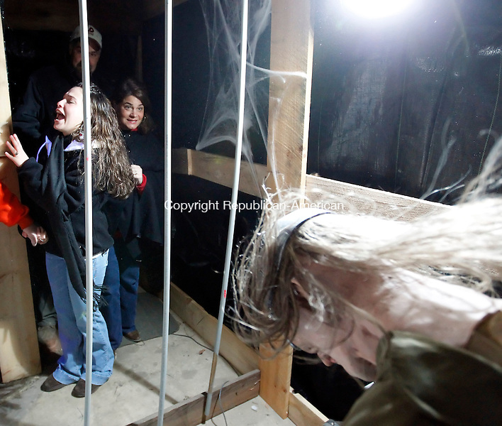Torrington CT- 22, October 2010-102210CM04  A group of people walk through Frankenstein's Haunted House Friday night at RBJ warehouse in Winsted. The Haunted House will be open tonight (Saturday) from 6:30-10pm, and Oct. 29th and 30th from 6:30-10pm.  All proceeds benefit area charities.  Christopher Massa Republican-American