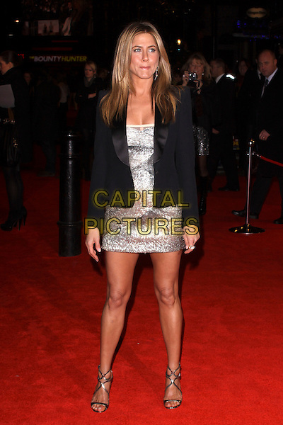 JENNIFER ANISTON .Attending 'The Bounty Hunter' UK film premiere at the Vue West End,cinema Leicester Square, London, England, UK. March 11th, 2010 .arrivals full length black jacket blazer silver metallic shiny dress strappy sandals grey gray open toe tuxedo tux beaded.CAP/AH.©Adam Houghton/Capital Pictures.