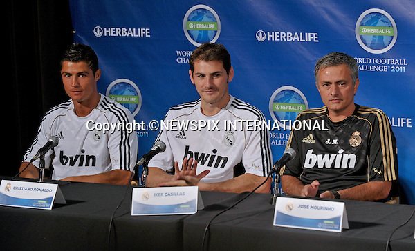 "CRISTIANO RONALDO, IKER CASILLAS WITH REAL MADIRD MANAGER JOSE MOURINHO.at the Herbalife World Football Challenge Superstar Press Conference at Creative Artists Agency's Ray Kurtzman Theatre, Century City, California_12/07/2011.Mandatory Photo Credit: ©Crosby/Newspix International. .**ALL FEES PAYABLE TO: ""NEWSPIX INTERNATIONAL""**..PHOTO CREDIT MANDATORY!!: NEWSPIX INTERNATIONAL(Failure to credit will incur a surcharge of 100% of reproduction fees).IMMEDIATE CONFIRMATION OF USAGE REQUIRED:.Newspix International, 31 Chinnery Hill, Bishop's Stortford, ENGLAND CM23 3PS.Tel:+441279 324672  ; Fax: +441279656877.Mobile:  0777568 1153.e-mail: info@newspixinternational.co.uk"