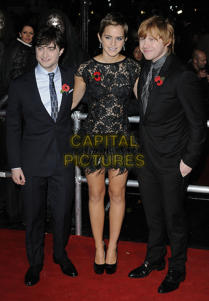 "DANIEL RADCLIFFE, EMMA WATSON & RUPERT GRINT .""Harry Potter And The Deathly Hallows: Part 1"" World Film Premiere, Empire cinema Leicester Square and Odeon Leicester Square, London, England, UK, 11th November 2010. .full length black sheer see thru through feathers suit tie poppy platform shoes blue grey gray cast dress lace.CAP/CAN.©Can Nguyen/Capital Pictures."