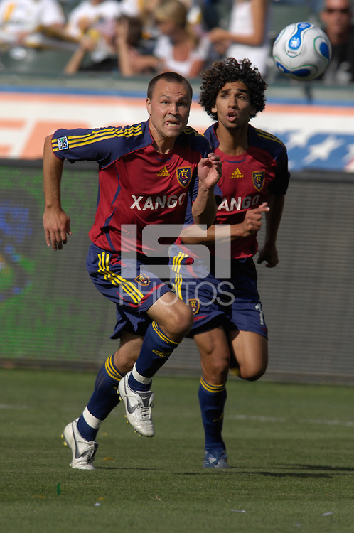 Chris Brown runs for the ball as teammate Medhi Ballouchy looks on. The Los Angeles Galaxy defeated Real Salt Lake, 3-2, at the Home Depot Center in Carson, CA on Sunday, June 17, 2007.
