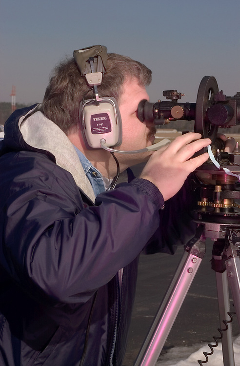 16868Tom Brooks working on Theodolite at Airport