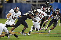 25 October 2011:  FIU running back Brandon Bennett (36) tackles Troy running back Justin Albert (15) during a punt return in the second quarter as the FIU Golden Panthers defeated the Troy University Trojans, 23-20 in overtime, at FIU Stadium in Miami, Florida.