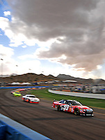 Nov. 9, 2008; Avondale, AZ, USA; NASCAR Sprint Cup Series driver Carl Edwards (99) leads a pack of drivers during the Checker Auto Parts 500 at Phoenix International Raceway. Mandatory Credit: Mark J. Rebilas-