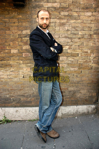 "GABRIEL RANGE.Photocall for the film ""Death of a President"" at Cinema Quattro fontane, Rome, Italy..March 5th, 2007.director full length black suit jacket beard facial hair arms crossed jeans denim .CAP/CAV.©Luca Cavallari/Capital Pictures"
