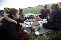 Pictured: Refugees have food on the ground Thursday 25 February 2016<br /> Re: Refugees have been left stranded in temporary camps after Greek FYRO Macedonian borders were closed in Idomeni, northern Greece.