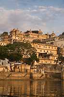 Late afternoon light illuminates the CITY PALACE of UDAIPUR and PICHOLA LAKE- RAJASTHAN, INDIA