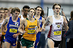 BROOKINGS, SD - FEBRUARY 25:  Robert Murphy from IUPUI, right, leads the pack during the men's mile run at the 2017 Summit League Indoor Track and Field Championship Saturday afternoon in Brookings, SD. (Photo by Dave Eggen/Inertia)