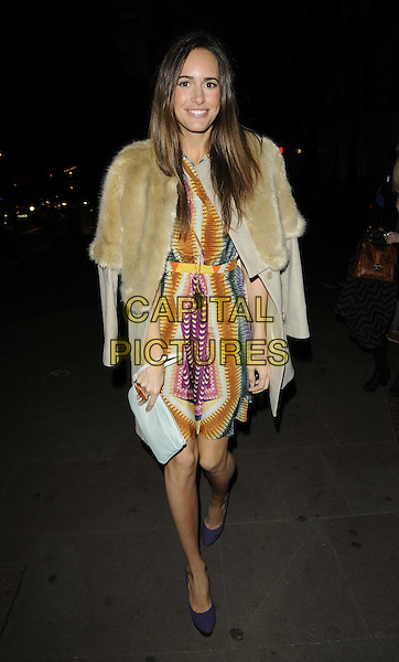 Louise Roe.attending the LOOK magazine 5th anniversary party, One Marylebone, Marylebone Rd., London, England, UK, .1st March 2012..full length fur coat  yellow print purple dress  blue shoes white clutch bag belt .CAP/CAN.©Can Nguyen/Capital Pictures.