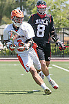 Orange, CA 05/02/10 - David Sigley (Biola # 8) and Andrew Hauke (CS Fullerton # 2) in action during the Biola-Cal State Fullerton MCLA SLC Division II final game in Wilson Field at Chapman University.  CS Fullerton earned a consecutive appearance at the Nationals by defeating Biola 12-7.
