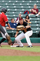 Rochester Red Wings First Baseman Matt Macri (5) gets a throw from the pitcher on a pick off attempt during a game vs. the Norfolk Tides at Frontier Field in Rochester, New York;  May 31, 2010.   Norfolk defeated Rochester by the score of 2-1.  Photo By Mike Janes/Four Seam Images