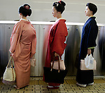 Maiko wait to board the Shinkansen train at Tokyo Station