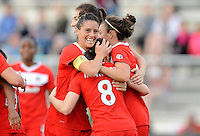 Boyds MD - April 19, 2014: Ali Krieger (11) of the Washington Spirit celebrates Diana Matheson's score. The Washington Spirit defeated the FC Kansas City 3-1 during a regular game of the 2014 season of the National Women's Soccer League at the Maryland SoccerPlex.