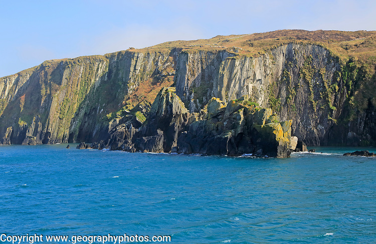 Sheer cliff vertical sedimentary rock strata, west coast Cape Clear Ireland, County Cork, Ireland, Irish Republic