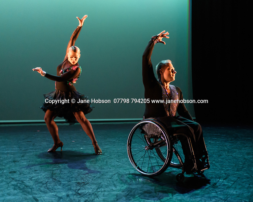 Step Change Studios present their ballroom show Fusion, at Sadler's Wells' Lilian Baylis Studio. Fusion is the UK's first inclusive Latin and ballroom dance showcase by disabled and non-disabled artists, drawing on different dance influences such as swing and contemporary to develop original pieces inspired by Latin and ballroom. Picture shows: SHOW DANCE, created and performed by Nadine Kinczel and Pawel Karpinski.