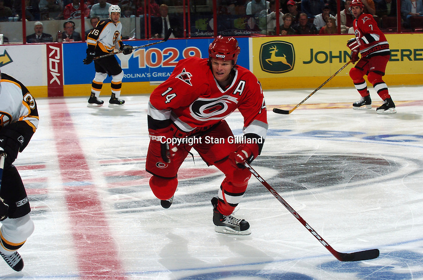 Carolina Hurricanes' Kevyn Adams races to the puck during a game with the Boston Bruins at the RBC Center in Raleigh, NC Wednesday, March 1, 2006. The Hurricanes won 4-3...