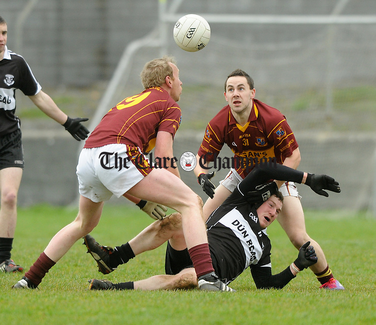 John Meade and Ian Sexton of Miltown in action against Kevin Pender of Doonbeg during their Cusack Cup game at Miltown. Photograph by John Kelly.