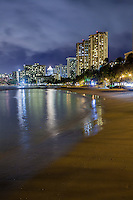 Hotels with lights reflecting off the water at night, seen from Kuhi'o Beach (a.k.a. The Ponds) in Waikiki, O'ahu.