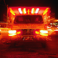 Ambulance with emergency lights on