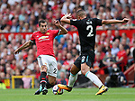 Manchester United's Henrikh Mkhitaryan tussles with West Ham's Winston Reid during the premier league match at Old Trafford Stadium, Manchester. Picture date 13th August 2017. Picture credit should read: David Klein/Sportimage