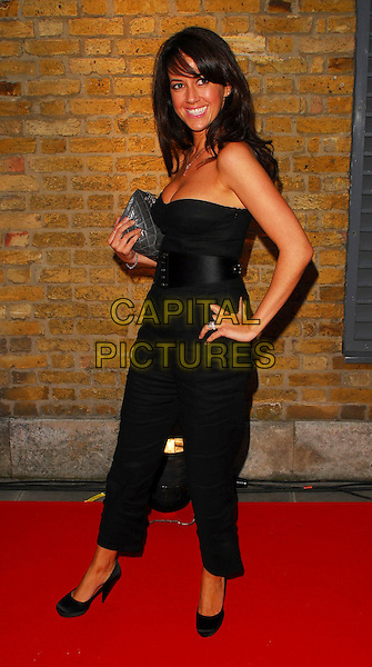 SHEREE MURPHY.OK! Magazine - private 10th anniversary party, Old Billingsgate, London, UK..May 10th, 2006.Ref: CAN.full length black trousers strapless top belt hand on hip.www.capitalpictures.com.sales@capitalpictures.com.©Capital Pictures
