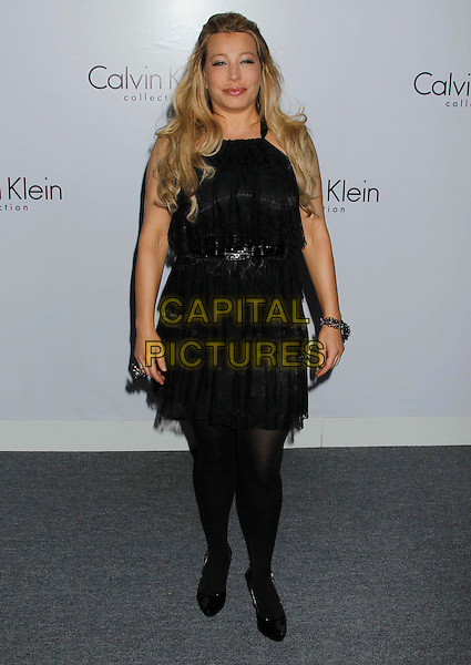 TAYLOR DANE .Attending Calvin Klein Collection and LOS ANGELES NOMADIC DIVISION present a celebration of L.A. Arts Month held at the Calvin Klein Store, Los Angeles, CA, USA, 28th January 2010..full length black dress tiered ruffles ruffle tights patent shoes waist belt .CAP/ADM/MJ.©Michael Jade/Admedia/Capital Pictures
