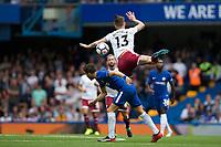 Burnley's Jeff Hendrick is fouled by Chelsea's Cesc Fabregas<br /> <br /> Photographer Craig Mercer/CameraSport<br /> <br /> The Premier League - Chelsea v Burnley - Saturday August 12th 2017 - Stamford Bridge - London<br /> <br /> World Copyright &copy; 2017 CameraSport. All rights reserved. 43 Linden Ave. Countesthorpe. Leicester. England. LE8 5PG - Tel: +44 (0) 116 277 4147 - admin@camerasport.com - www.camerasport.com